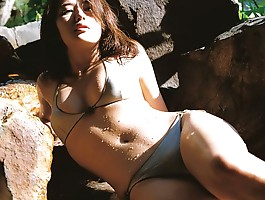 Captivating asian goddess seduces in her skimpy black bikini